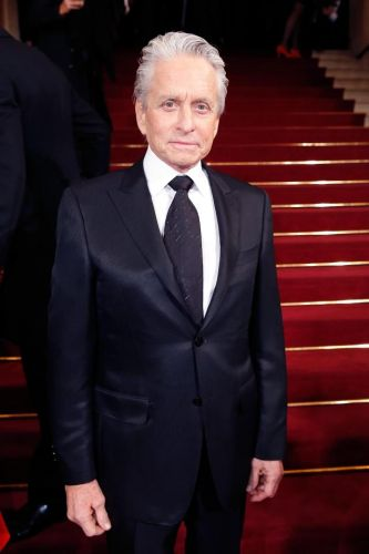 How old is Michael Douglas, how long's he been married to wife Catherine Zeta-Jones, who's his father Kirk and what are his hit movies?