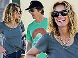 Julia Roberts beams in T-shirt and jeans while enjoying vacation in Hawaii with her husband and kids