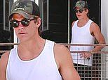 Chris Pine shows off his muscled biceps in a white tank top before hitting the gym with a friend