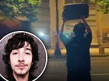 Shocking moment officer shoots peaceful protester, 26, in the head with a 'rubber bullet'