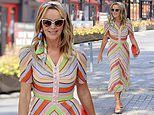 Amanda Holden embodies summer in a rainbow-coloured striped dress as she leaves work at Heart FM