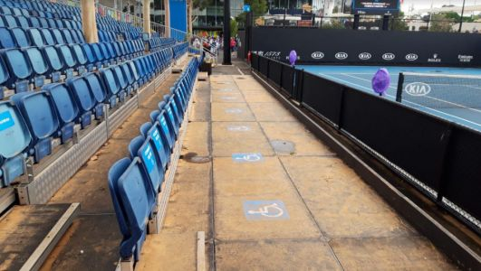 Australian Open staff frantic attempts to clear courts of Outback dust in Melbourne