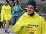 Justin Bieber models flowing Balenciaga hoodie as he steps out with wife Hailey