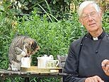 Hilarious moment Tiger the cathedral moggy drinks the Dean of Canterbury's milk