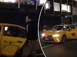Video shows 'officers detain a man in their undercover police taxi car'