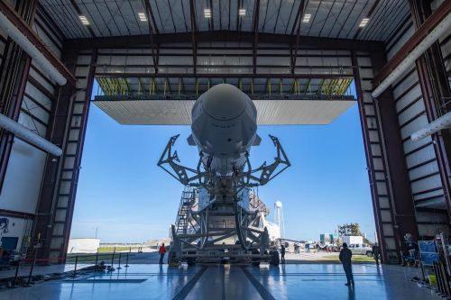 Photos: Upgraded Dragon cargo capsule rolls out to pad 39A
