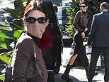 Kendall Jenner shows off her slender figure in a black gown at Milan Fashion Week