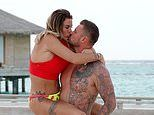 Katie Price straddles shirtless boyfriend Carl Woods during PDA-fest on the beach in the Maldives