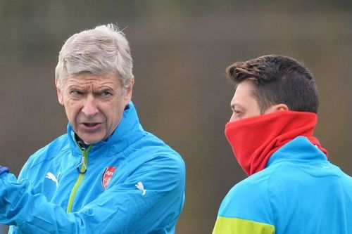 Arsene Wenger sends message to Mesut Ozil as he's axed from Arsenal squad