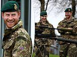 Harry's back in uniform! Prince arrives at the Royal Marines base in Devon for a day of training