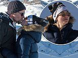 Kaley Cuoco kisses husband Karl Cook in front of a snow covered mountain on honeymoon to Switzerland