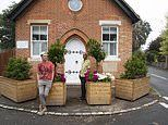 Couple who built planters to stop cars crashing through their home are told to remove them