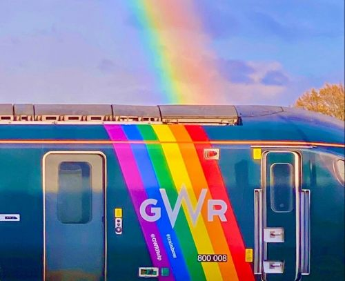 Commuter snaps 'miracle rainbow' above pride flag on train