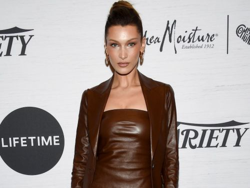 Bella Hadid went braless under a sheer halter top during her trip to the Caribbean