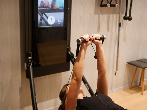 I tried the $3,000 digital weights machine that's like a Peloton for strength training and found how at-home fitness systems are the future - at least for those that can afford it