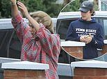 Jodie Comer and beau James Burke pack up the car in rainy Liverpool