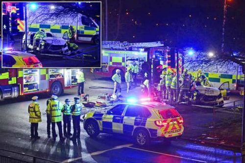Police car in horror smash as firefighters cut off roof and one taken to hospital