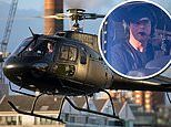Tom Cruise is every inch the action man as he lands his helicopter in London