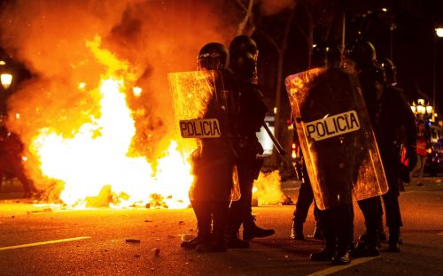 Separatist protesters set fire to barricades in streets of Barcelona