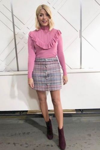 Holly Willoughby This Morning outfit today: Phillip Schofield's co-star holds on to the summer as she flaunts her pins in Topshop mini skirt, Temperley London jumper and Clergerie boots