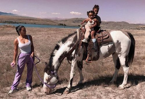 Kim Kardashian horses around with North and Chicago on husband Kanye West's new Wyoming ranch