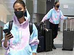 Joan Smalls cuts a casual figure in a tie-dye pink and blue hoodie as she arrives at Milan Airport