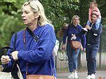 Zoe Ball enjoys a family day out to London Zoo with boyfriend Michael Reed and daughter Nelly, 10