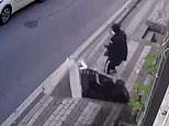Moment a man throws his old sofa out of the window and nearly kills his neighbour walking below