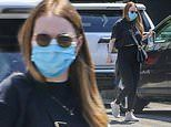 Emma Stone looks sleek in black as she heads to the gym three months after giving birth