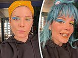 Halsey rocks a blue wig and mismatched eye shadow as she shows off her pro-level makeup skills