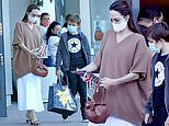 Angelina Jolie carries a purse named after activist Nina Simone as she takes Knox to a game store