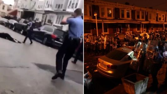 Riots erupt after police shoot black man with knife dead in front of his mother
