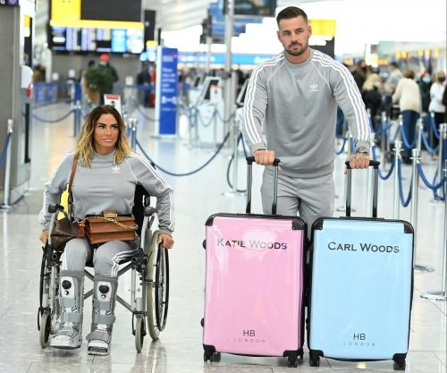 Katie Price and Carl Woods show off matching 'Woods' suitcases and identical tracksuits as they jet off to the Maldives
