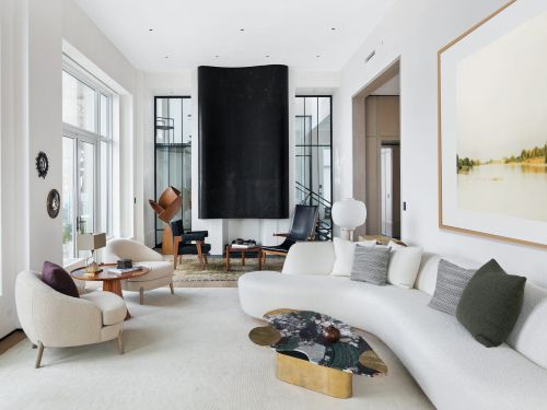 3 top execs at hedge fund Elliott Management have put their New York apartments up for sale as the firm moves to Miami. See inside one of the $39.5 million homes