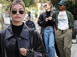 Hailey Bieber rocks a leather overcoat for a lunch date with her friend Justine Skye
