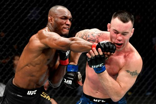 Kamaru Usman scores dramatic fifth round KO against bitter rival Colby Covington to retain UFC welterweight title