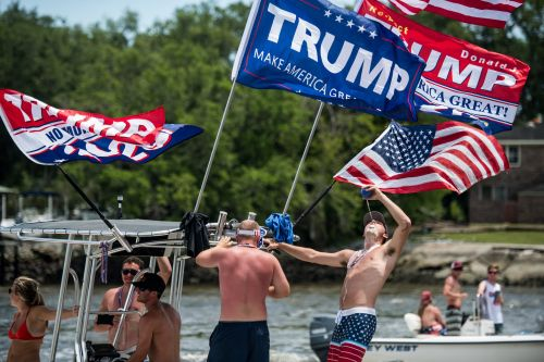 Hundreds of unmasked revelers enjoyed a 'MAGA Boat Parade' in South Carolina as American coronavirus death toll approaches 100,000