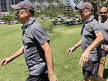 Tom Hanks looks fit as he goes for a power walk in Queensland