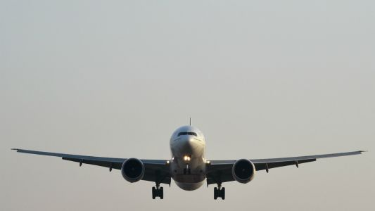 How much would a carbon charge add to flight ticket prices?