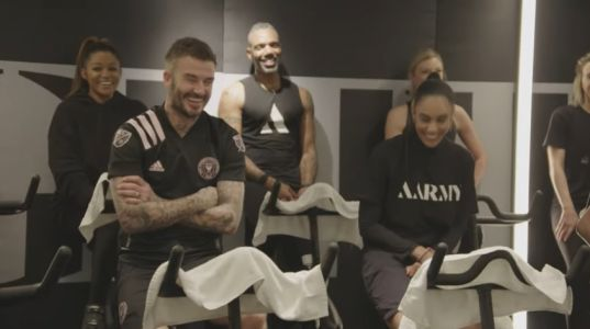 David Beckham channels Posh as he sings Spice Girls hit Wannabe during spin class with James Corden
