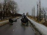 Moment huge wheel breaks off a tractor and bounces into the windscreen of a passing car in Russia
