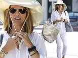 Lori Loughlin dons floppy sun hat in LA while awaiting trial on college admissions scandal charges