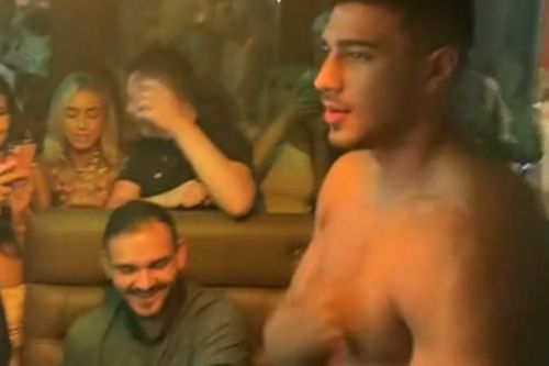 Tommy Fury strips topless and beats chest as he parties with fans in Liverpool