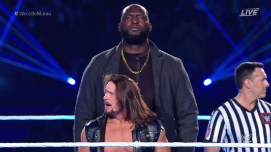 How tall is Omos? WWE giant and AJ Styles win tag team titles at WrestleMania 37
