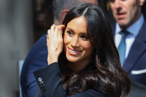 Kensington Palace confirms who WILL walk Meghan down the aisle