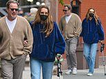 Brooke Shields leans on her husband of 20 years Chris Henchy while walking with a cane