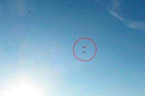 Three paragliders collide mid-air before plunging into sea as horrified spectators watch