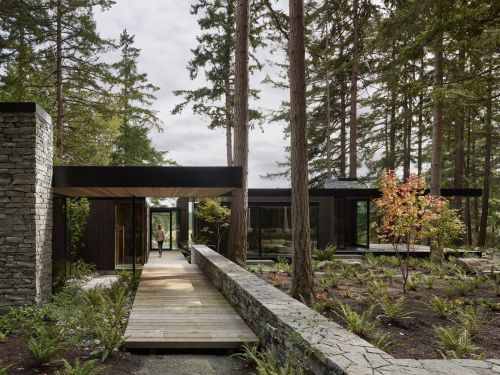 Look inside the glass 'farmhouse' a family built on their historic property off the coast of Seattle