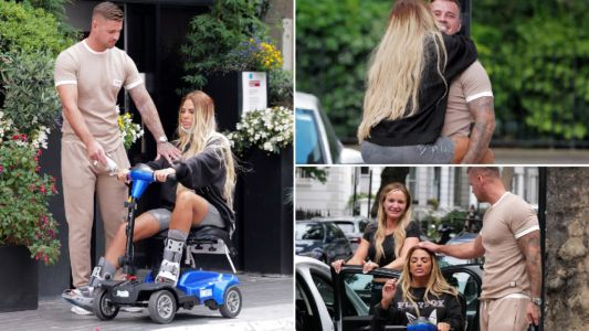 Katie Price's supportive boyfriend Carl Woods carries her to hospital appointment for broken feet